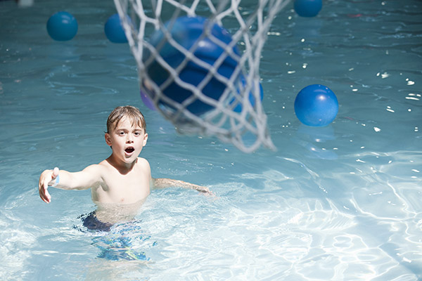 Child Playing Solo Pool Basketball